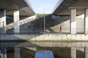 man jogs under fly-over near De Meern in The Netherlands