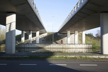 man on bicycle near De Meern under fly-over