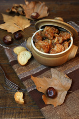 Pork stew with chestnuts and autumn leaves