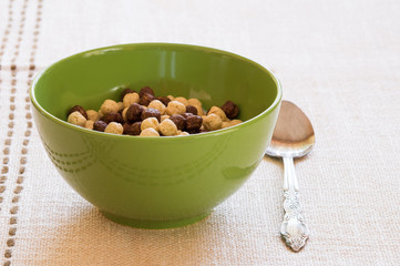 Prepared breakfast with cereals in a green bowl