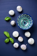 Still life with chinese solo garlic. Dark blue wooden background