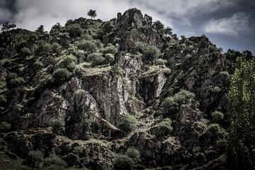 Rocky mountain. Landscape toned in black-white. Tajikistan