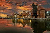 The riverside with the characteristic Crane of Gdansk, Poland. - 73739349