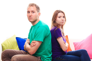 Offended boy with a girl on the sofa at home