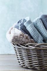 Folded Bath Towels in a Rustic Basket
