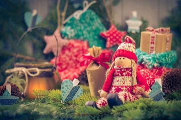 Santa Claus Christmas ornaments green pine needles cones gifts