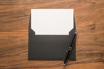 Blank paper, envelope and pen