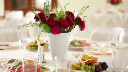 beautiful wedding table in the restaurant with flowers on the ta