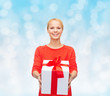 smiling woman in red clothes with gift box
