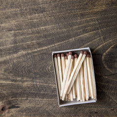 safety matches on wooden table
