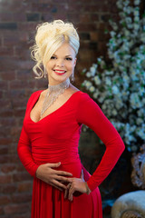 Portrait of blondie woman in red dress