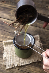 woman pouring freshly infused tea