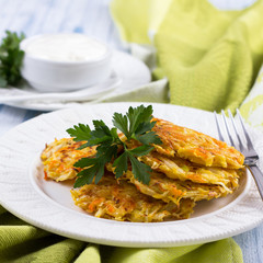 Vegetable fritters with cabbage and carrots on a blue background