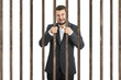 businessman behind the prison cell