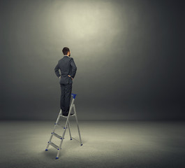 man standing on the stepladder