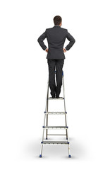 man standing over white