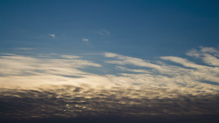 cloud front moves against the sunset