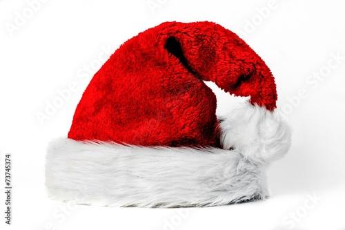 Leinwanddruck Bild Pelzige Weihnachtsmütze auf weiß isoliert