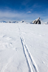 Ski track on fresh snow. Winter sport background with the famous