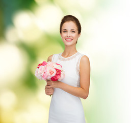 smiling woman in white dress with bouquet of roses