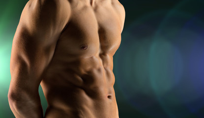 close up of male bodybuilder bare torso
