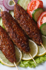 kebabs with vegetables close-up. vertical top view