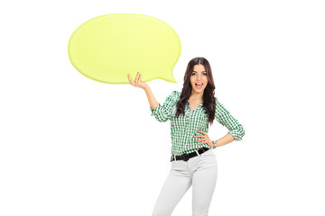 Young girl holding a yellow speech bubble
