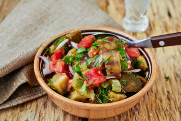 Baked vegetable salad with eggplant, paprika and tomato