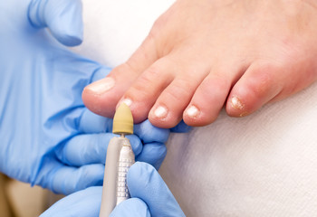 process of pedicure at beauty salon fingers hands