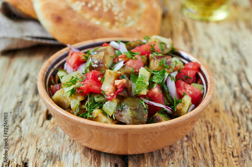 Baked vegetable salad with eggplant, paprika and tomato - 73746903