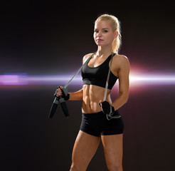 sporty woman with skipping rope