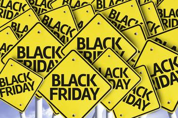 Black Friday written on multiple road sign