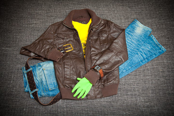 Fashion concept: leather jacket, jeans, belt, shirt and watch