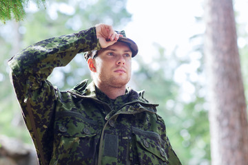 young soldier or ranger in forest