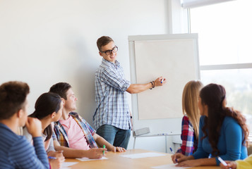 group of smiling students with white board