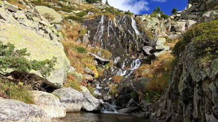 Beautiful veil cascading waterfall, mossy rocks