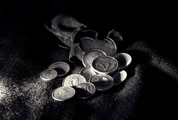 Euro coins scattered on the cashmere