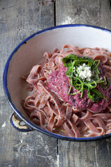 pasta tagliatelle with beetroot pesto, rocket and parmesan