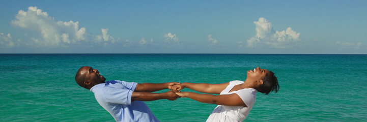 Happy young couple on blue ocean background.