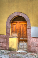 old wooden door in Bosa, Italy