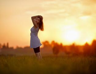 Girl against the sunset