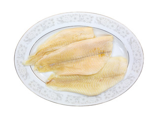 Fresh flounder fillets on oval platter