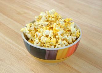 Bowl of popcorn on tabletop