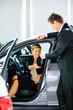 Seller gives keys to car girl in the salon