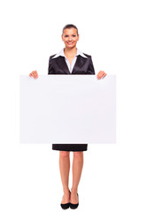 Happy smiling business woman showing blank signboard