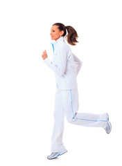 Young beautiful woman in fitness wear runs isolated