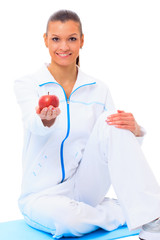 Fitness woman happy smiling holding apple