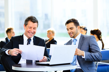 Image of business partners discussing documents