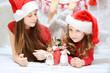 Two cute sisters enjoying the christmas