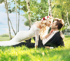 Marriage couple lying on the lawn